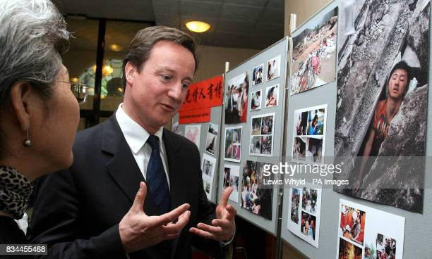 Conservative leader David Cameron with Chinese ambassador Fu Ying looking at pictures of devastation caused by the Sichuan earthquake at the Chinese...
