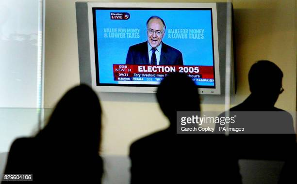 Conservative leader Michael Howard is shown on the large screen at the rear of today's press conference at Conservative Headquarters
