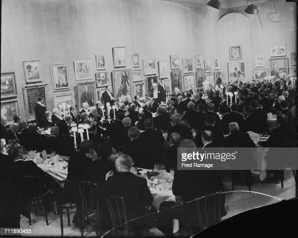 Conservative Leader of the Opposition Winston Churchill speaking at the inaugural banquet of the Royal Academy's summer season held at Burlington...