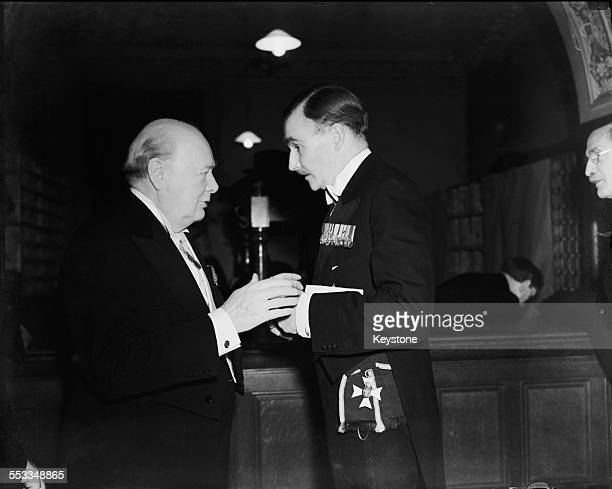 Conservative Leader of the Opposition Winston Churchill with Sir Alan Lascelles Private Secretary to King George VI at a Royal Academy banquet held...