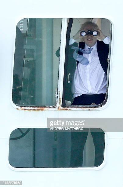 Conservative leadership candidate Boris Johnson looks through binoculars on the bridge of the Isle of Wight ferry as it sets sail from Portsmouth...