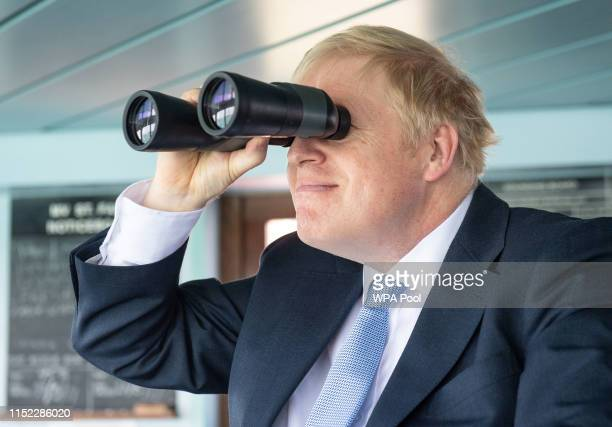 Conservative leadership candidate Boris Johnson looks through binoculars on the bridge of the Isle of Wight ferry as it sets sail on June 27 2019 in...