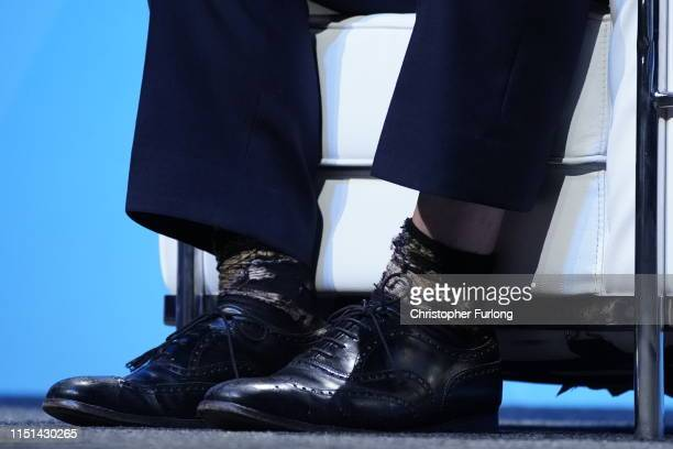 Conservative leadership candidate, Boris Johnson, sock detail, attends the first hustings on June 22, 2019 in Birmingham, England. Johnson and Hunt...