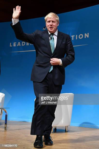 Conservative leadership candidate Boris Johnson waves after addressing an audience of party members as he takes part in a Conservative Party...