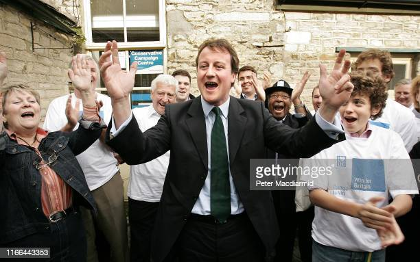 Conservative Leadership challenger David Cameron celebrates with supporters at his constituency office on October 21, 2005 in Witney, Oxfordshire,...