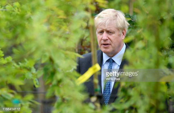 Conservative leadership contender Boris Johnson looks at a tree during a photo opportunity at King and Co Tree Nursery on July 13 2019 in Braintree...