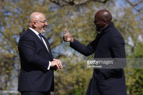 Conservative London Mayor candidate Shaun Bailey gives a thumbs up as he chats with Conservative MP and vaccines minister Nadhim Zahawi outside St...