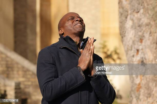 Conservative London Mayor candidate Shaun Bailey puts his hands together in a praying gesture as he speaks to the media outside St Mark's Church...