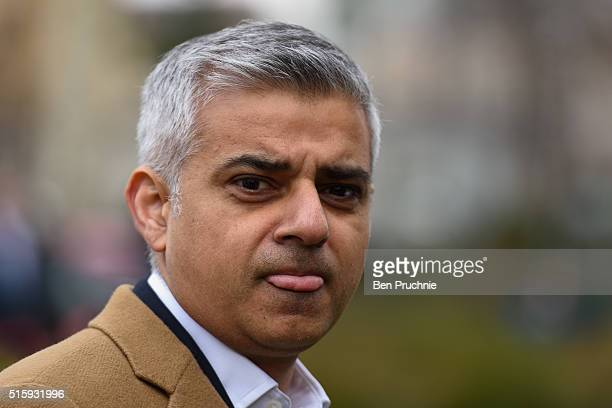Conservative Mayor of London Candidate Sadiq Khan is interviewed as he walks through Westminster British Chancellorof the Exchequer George Osborne...
