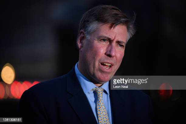 Conservative MP and Chairman of the 1922 Committee Graham Brady chats with a journalist outside the Houses of Parliament on October 20, 2020 in...