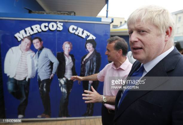 Conservative MP and leadership contender Boris Johnson campaigns with Britain's Wales Secretary Alun Cairns in Barry Island west of Cardiff in south...