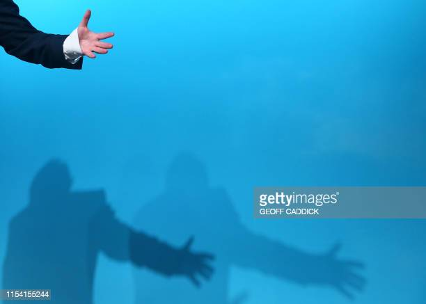 Conservative MP and leadership contender Boris Johnson gestures casting a shadow as he takes part in a Conservative Party Hustings event in Cardiff...
