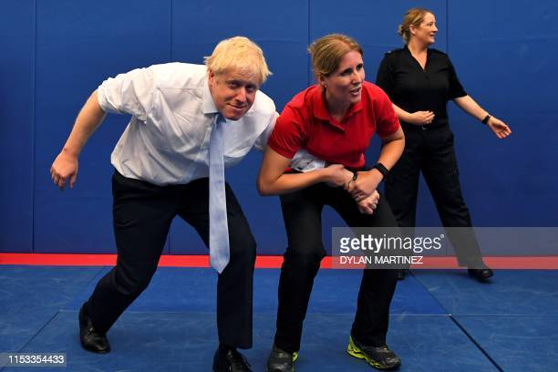 Conservative MP and leadership contender Boris Johnson reacts during his visit to the Thames Valley Police Training Centre in Reading, west of London...