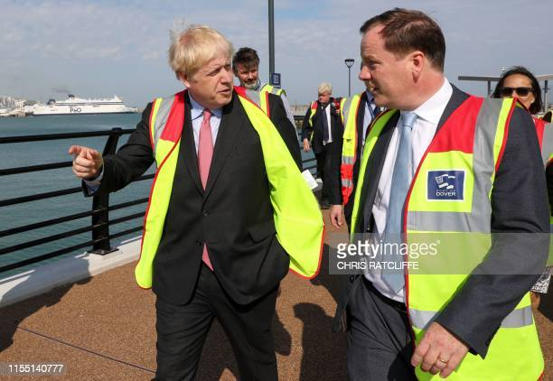 Conservative MP and leadership contender Boris Johnson speaks with Dover's Conservative MP Charlie Elphicke during a visit to the Port of Dover Ltd...