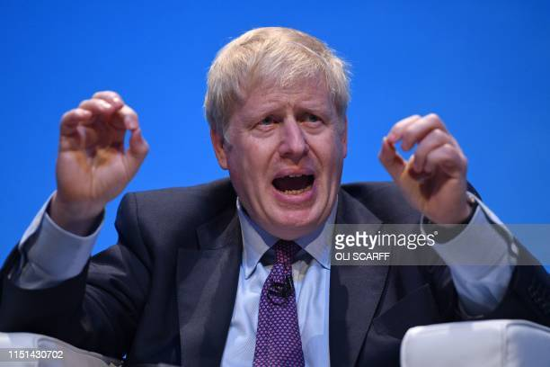 Conservative MP Boris Johnson gestures as he answers questions from journalist Iain Dale as he takes part in a Conservative Party leadership hustings...