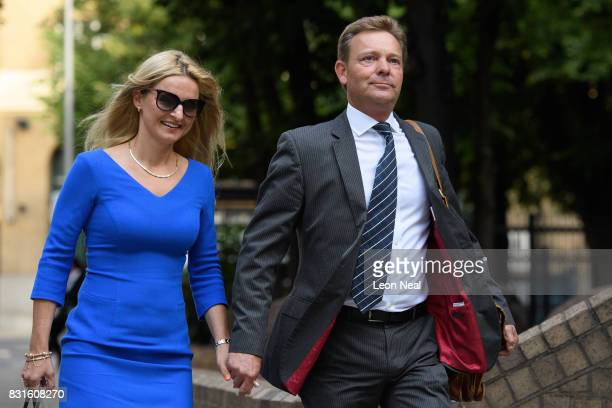 Conservative MP Craig Mackinlay arrives at Southwark Crown Court with his wife Kati ahead of the trial into charges of illegal election spending...