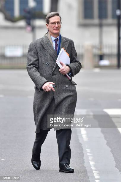 Conservative MP Dominic Grieve walks along Whitehall near the Houses of Parliament in London after seven people were arrested in raids in London...