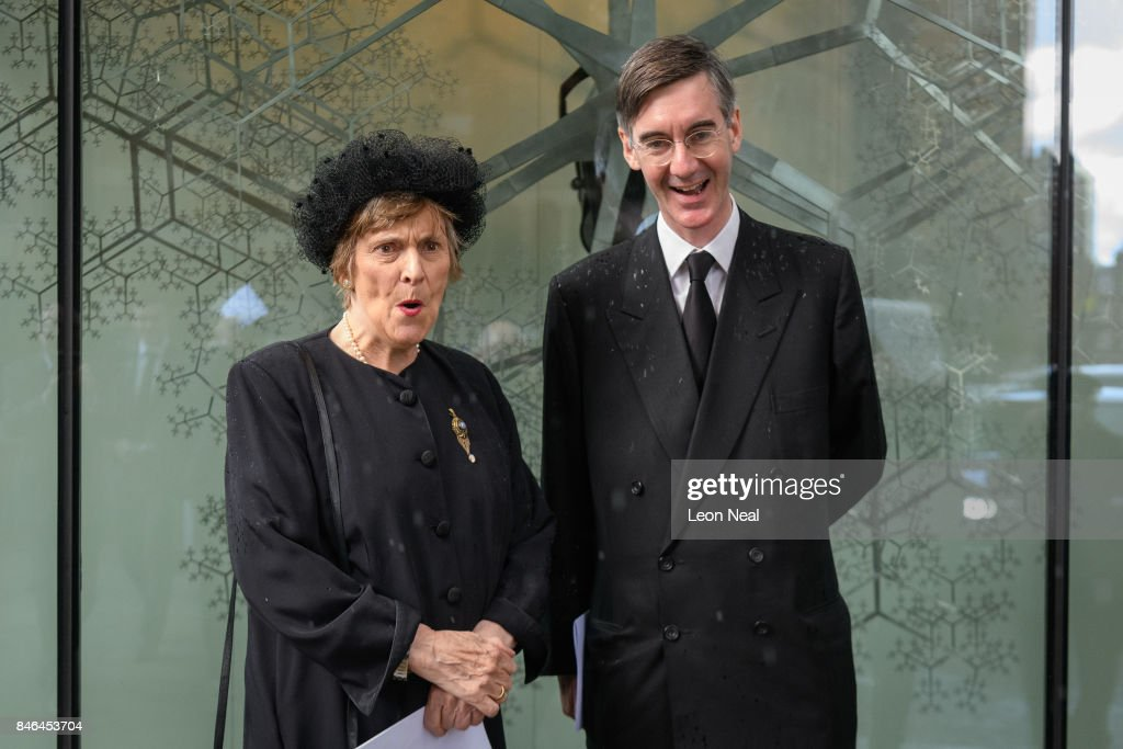 Conservative MP for North East Somerset Jacob Rees-Mogg (R) stands with his mother Gillian outside Westminster Cathedral following the funeral of the late British Cardinal Cormac Murphy-O'Connor, on September 13, 2017 in London, England. The 85-year-old died on September 1 after a battle with cancer.