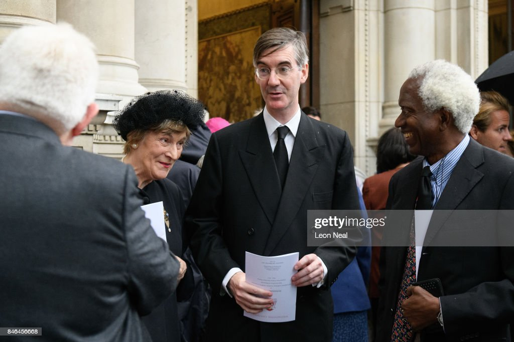 Conservative MP for North East Somerset Jacob Rees-Mogg (C) stands with his mother Gillian (2L) outside Westminster Cathedral following the funeral of the late British Cardinal Cormac Murphy-O'Connor, on September 13, 2017 in London, England. The 85-year-old died on September 1 after a battle with cancer.