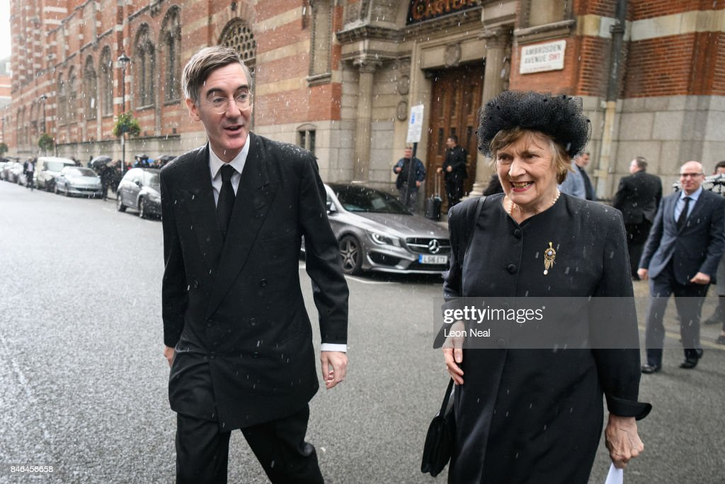 Conservative MP for North East Somerset Jacob Rees-Mogg (L) walks with his mother Gillian outside Westminster Cathedral following the funeral of the late British Cardinal Cormac Murphy-O'Connor, on September 13, 2017 in London, England. The 85-year-old died on September 1 after a battle with cancer.