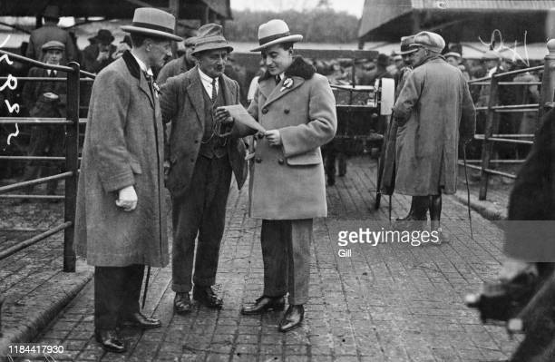 Conservative MP for Penryn and Falmouth, Captain Denis Shipwright , reading an address at a market in Plymouth during the UK general election...