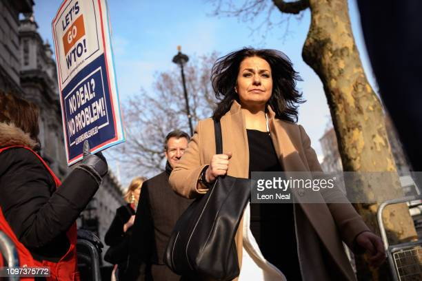 Conservative MP Heidi Allen passes a proBrexit protester after leaving the Cabinet Office following a Brexit meeting with Theresa May's Chief of...