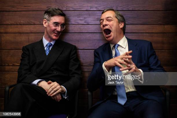 Conservative MP Jacob ReesMogg and British MEP Nigel Farage attend a 'Leave Means Leave' Brexit rally at the Queen Elizabeth II Centre on December 14...