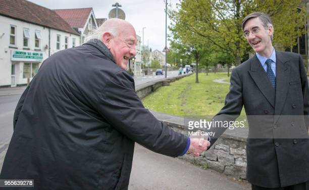 Conservative MP Jacob Rees-Mogg stops to talk people as he walks along the main street near his constituency office in Keynsham on May 4, 2018 in...