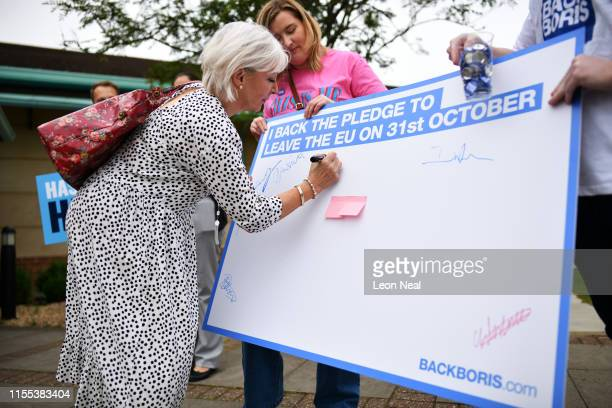 Conservative MP Nadine Dorries signs a board backing the pledge to leave the EU on October 31st before the Conservative leadership hustings on July...