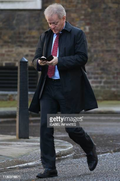 Conservative MP Philip Lee arrives in Downing Street in London on March 14 ahead of a further Brexit vote British MPs will vote today on whether to...
