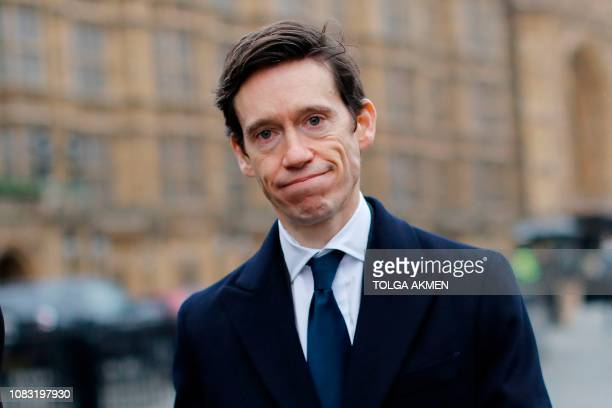 Conservative MP Rory Stewart reacts as he walks past the Houses of Parliament in central London on January 16 2019 Prime Minister Theresa May was...