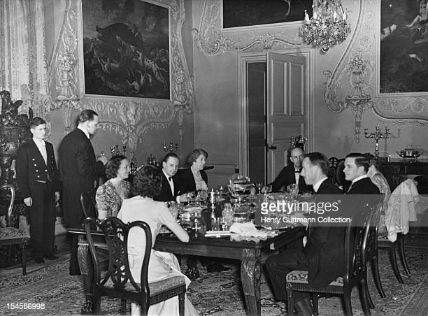 Conservative MP Thomas FermorHesketh 1st Baron Hesketh dining with members of his family at Easton Neston Northamptonshire circa 1940 The family is...