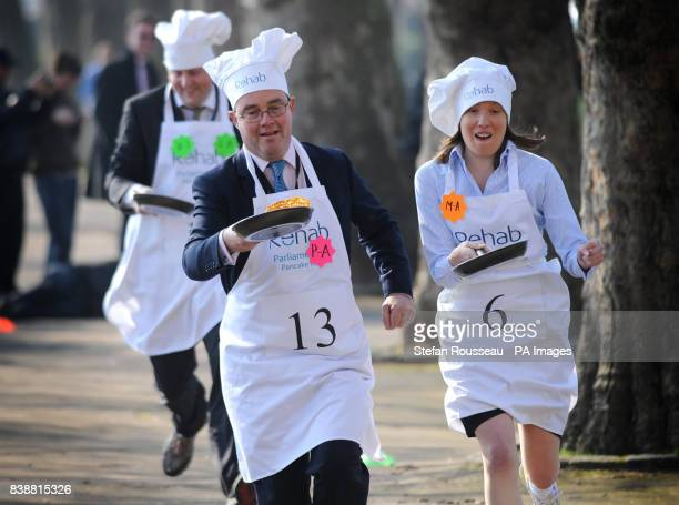 Conservative MP Tracey Crouch and Channel Four Political Editor Gary Gibbon compete in the annual Rehab UK Parliamentary Pancake Race in Westminster...