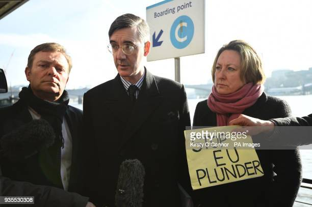Conservative MPs Craig Mackinlay and AnneMarieTrevelyan stand with Jacob ReesMogg as they speak at a press conference on Embankment Pier on the River...