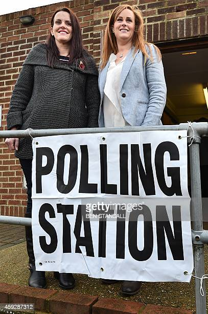 Conservative parliamentary candidate Kelly Tolhurst and sister Katie Tolhurst arrive to vote in the byelection in Rochester Kent southern England on...