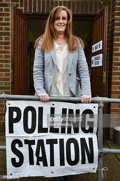 Conservative parliamentary candidate Kelly Tolhurst poses after casting her vote in the byelection in Rochester Kent southern England on November 20...