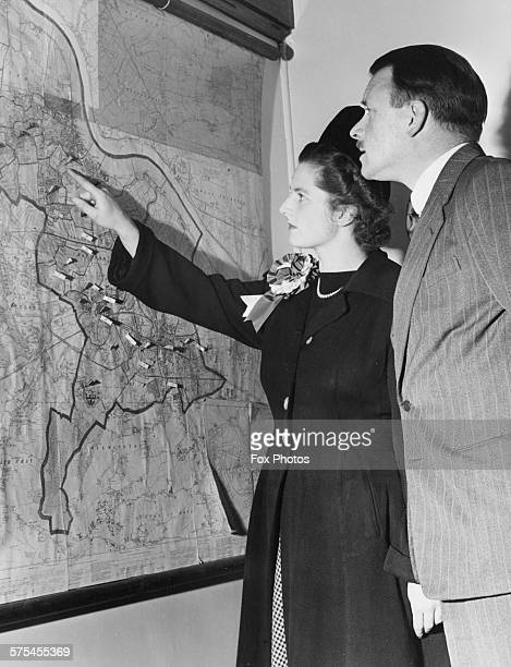 Conservative Parliamentary candidate Margaret Thatcher nee Roberts inspecting a map of her constituency during a canvassing tour Dartford Kent...