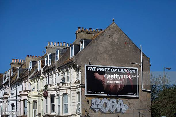 A UK Conservative party billboard poster sits on the side of residential property ahead of the May 7 general election in Hastings UK on Tuesday April...
