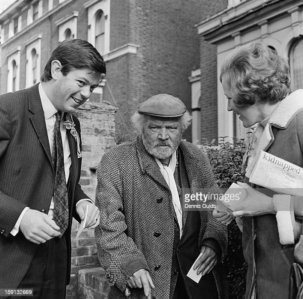 Conservative Party candidate Andrew Pearce and his wife Mira talk to an elderly constituent during the campaign in the parliamentary byelection for...