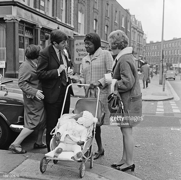 Conservative Party candidate Andrew Pearce talks to a constituent during his campaign in the parliamentary byelection for Islington North London 23rd...