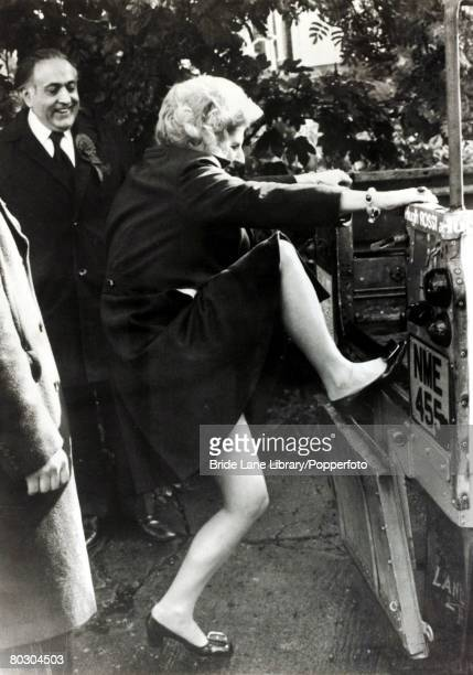 Conservative Party Housing Minister Margaret Thatcher, climbing aboard a Land Rover while supporting the local Tory candidate Hugh Rossi , Hornsey,...