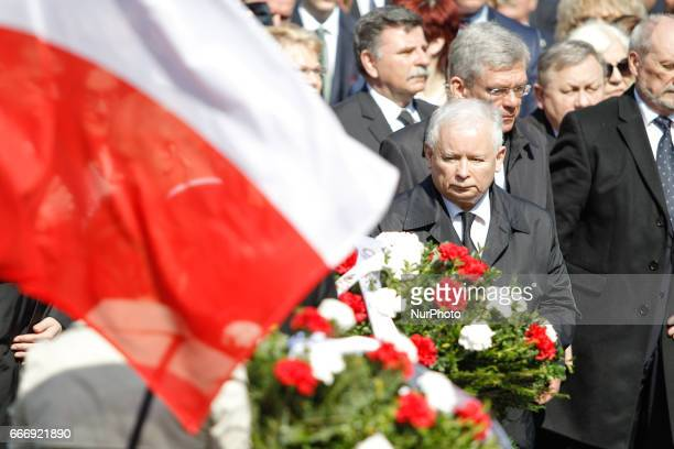 Conservative party leader and brother of late president Lech Kaczynski Jaroslaw Kaczynski is seen with PM Beata Szydlo at the military cemetary to...