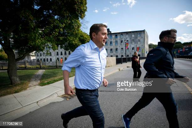 Conservative Party Leader Andrew Scheer runs as he crosses a street after a campaign stop on September 24 2019 in Cambridge Canada Scheer is facing...