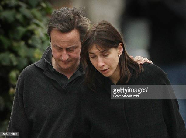 Conservative Party leader David Cameron and his wife Samantha walk to their house following the death of their 6yearold son on February 25 2009 in...