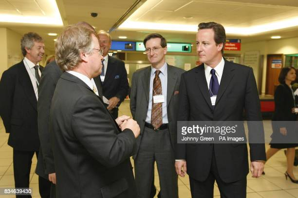 Conservative Party leader David Cameron and Shadow Home Secretary Dominic Grieve are shown around London City Airport by its Director of Business...