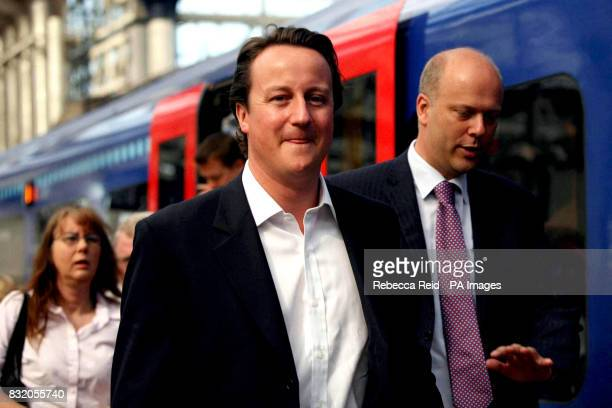 Conservative party leader David Cameron and Shadow Transport Secretary Chris Grayling arrive at Waterloo train station London after Mr Cameron's...