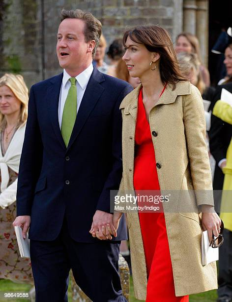 Conservative Party Leader David Cameron and wife Samantha attend the wedding of David's sister Clare to Jeremy Fawcus at St Barnabas Church on April...