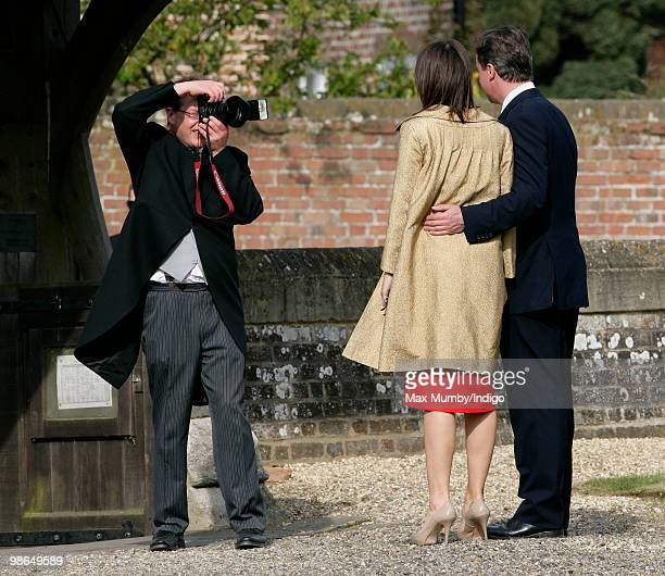 Conservative Party Leader David Cameron and wife Samantha pose for a photographer as they attend the wedding of David's sister Clare to Jeremy Fawcus...