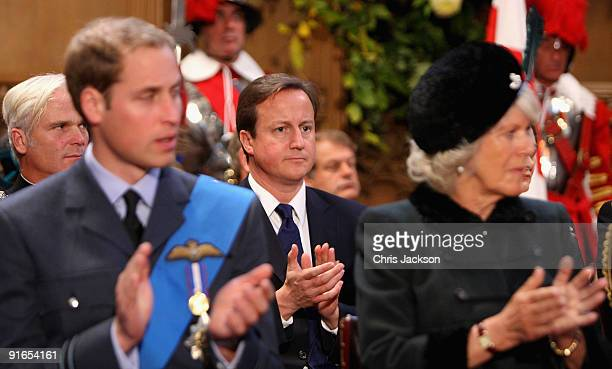 Conservative party leader David Cameron applauds behind TRH Camilla, Duchess of Cornwall and Prince Williamas they attend a reception at London...