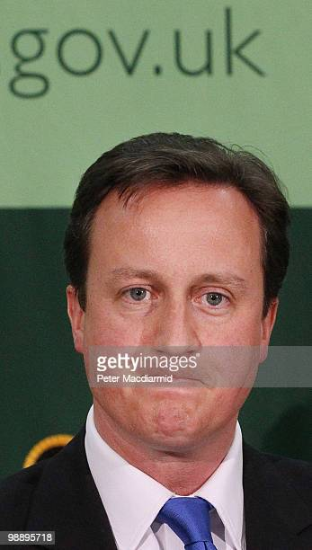 Conservative Party leader David Cameron delivers his acceptance speech after retaining his parliamentary seat in the constituency of Witney on May 7...